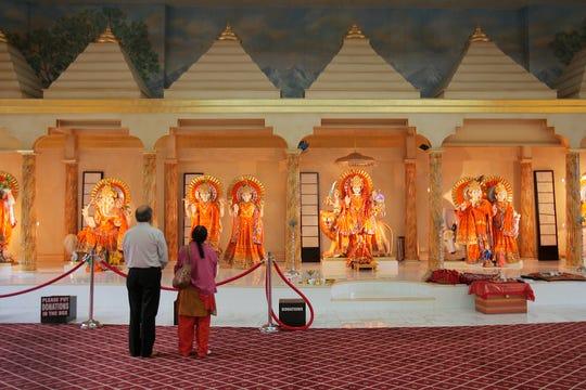 Bhanukumar Finavia of Cresskill and his wife Bhavana pray at the Hindu Samaj Temple in Mahwah on May 22, 2011.