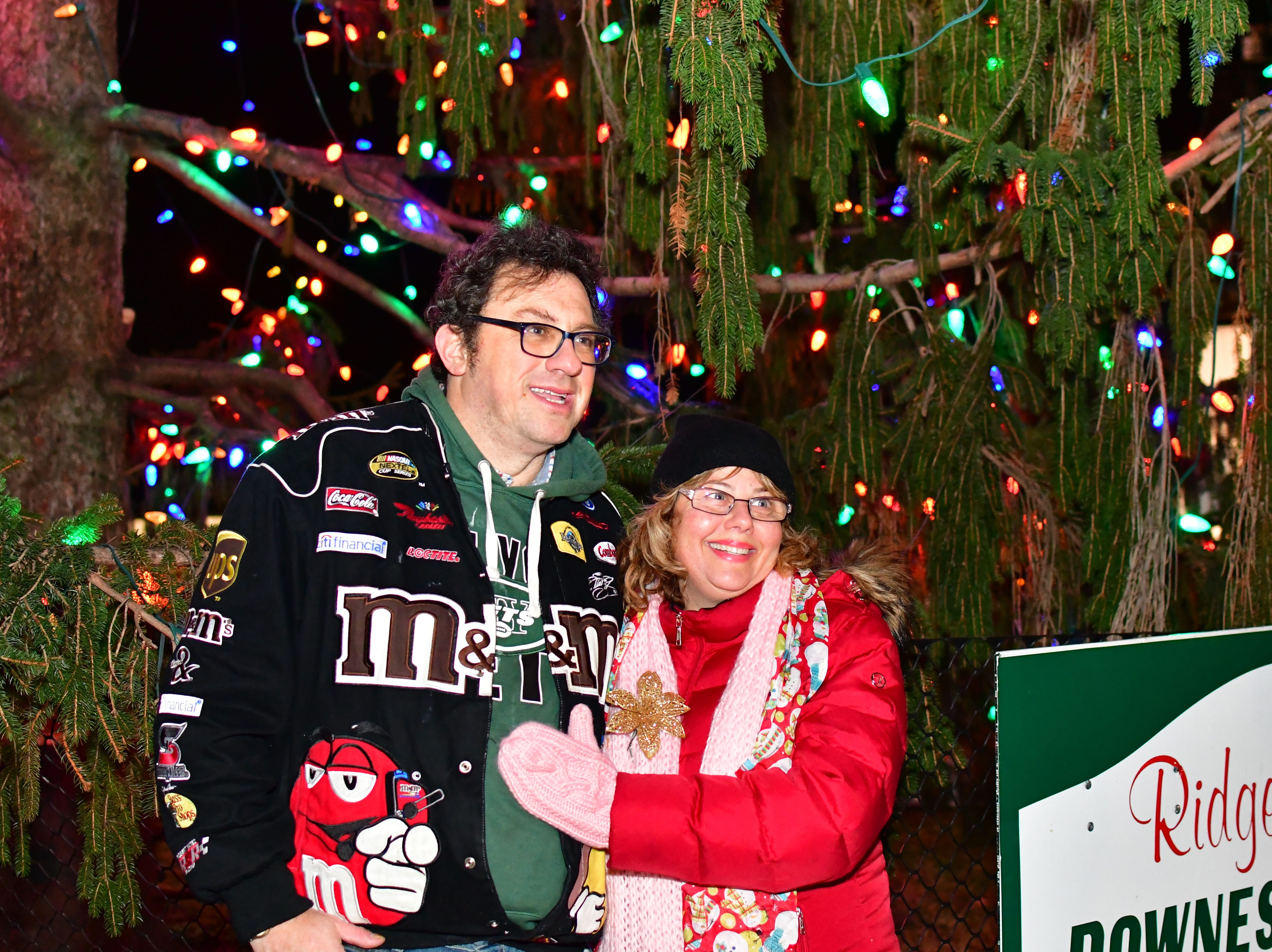 Wayne Elcher, left, and Iris Elcher, standing by the newly lit Christmas tree.  Holiday festivities along East Ridgewood Avenue in Ridgewood on Nov. 30.