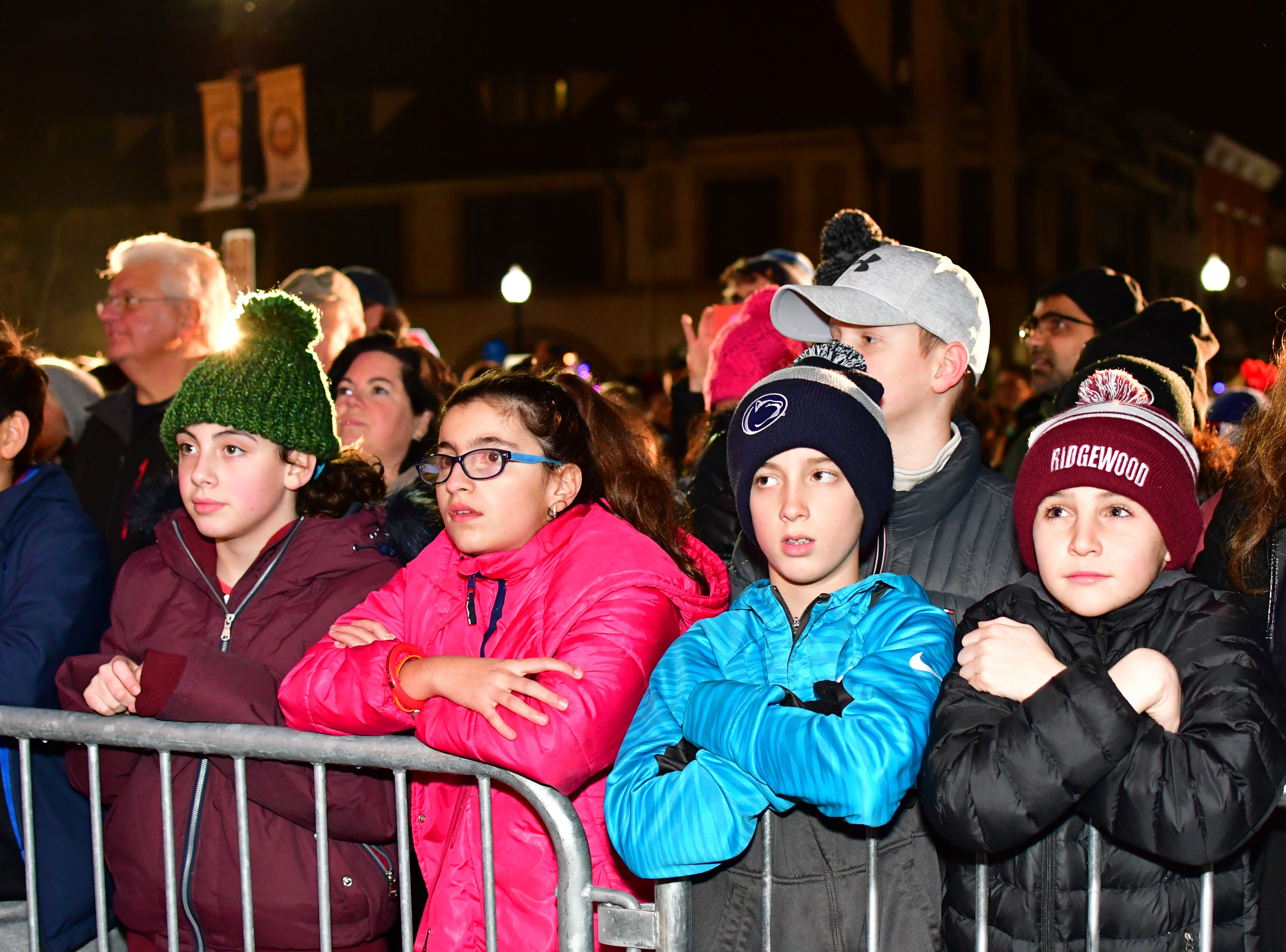 Young residents patiently wait along the street during the holiday festivities along East Ridgewood Avenue in Ridgewood on Nov. 30.