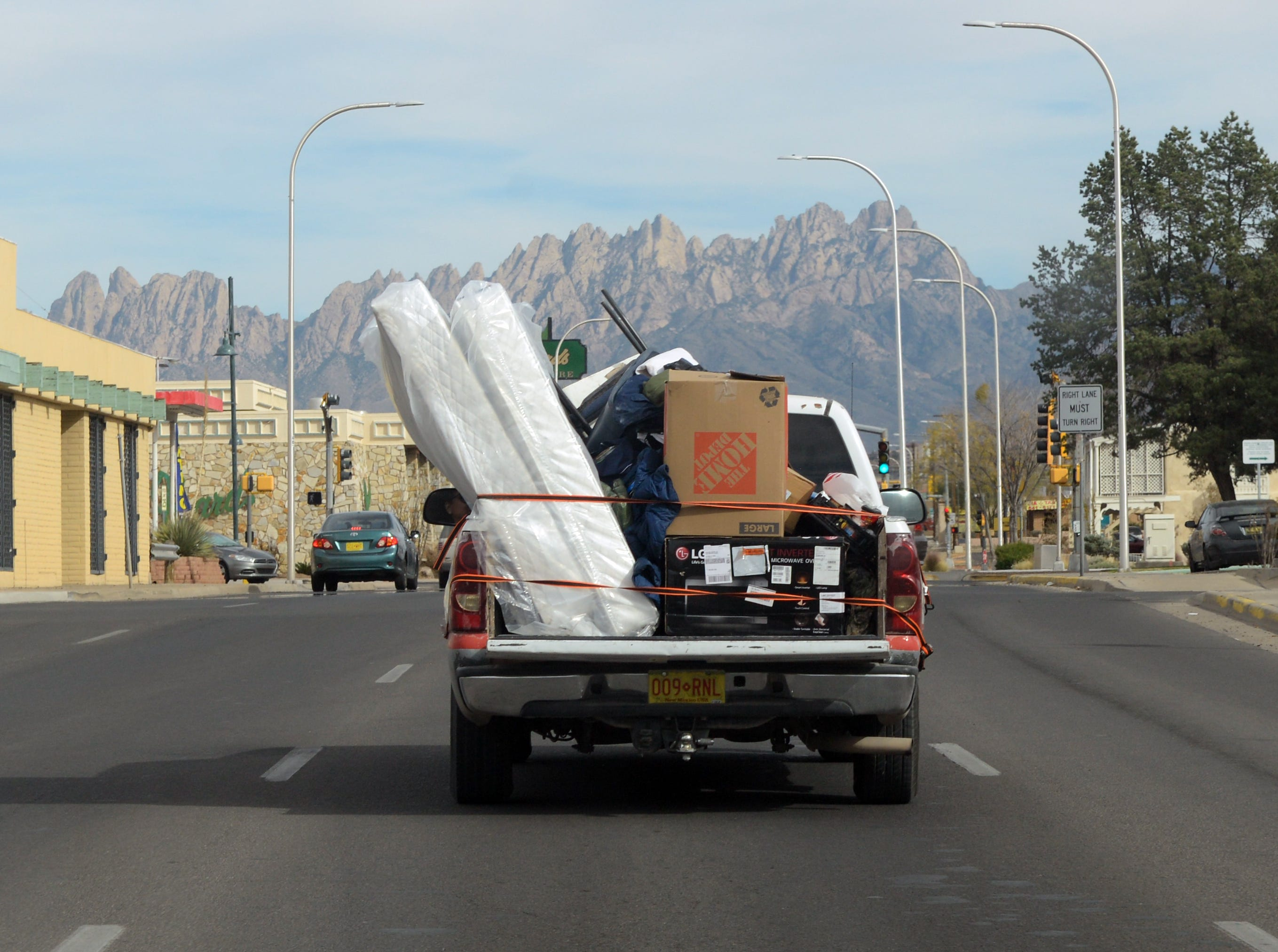 "Alan Abrams' possessions are carried by truck to his new apartment in Las Cruces. He was moved out of a tent city for the homeless as part of Community of Hope's ""Tents to Rents"" program."