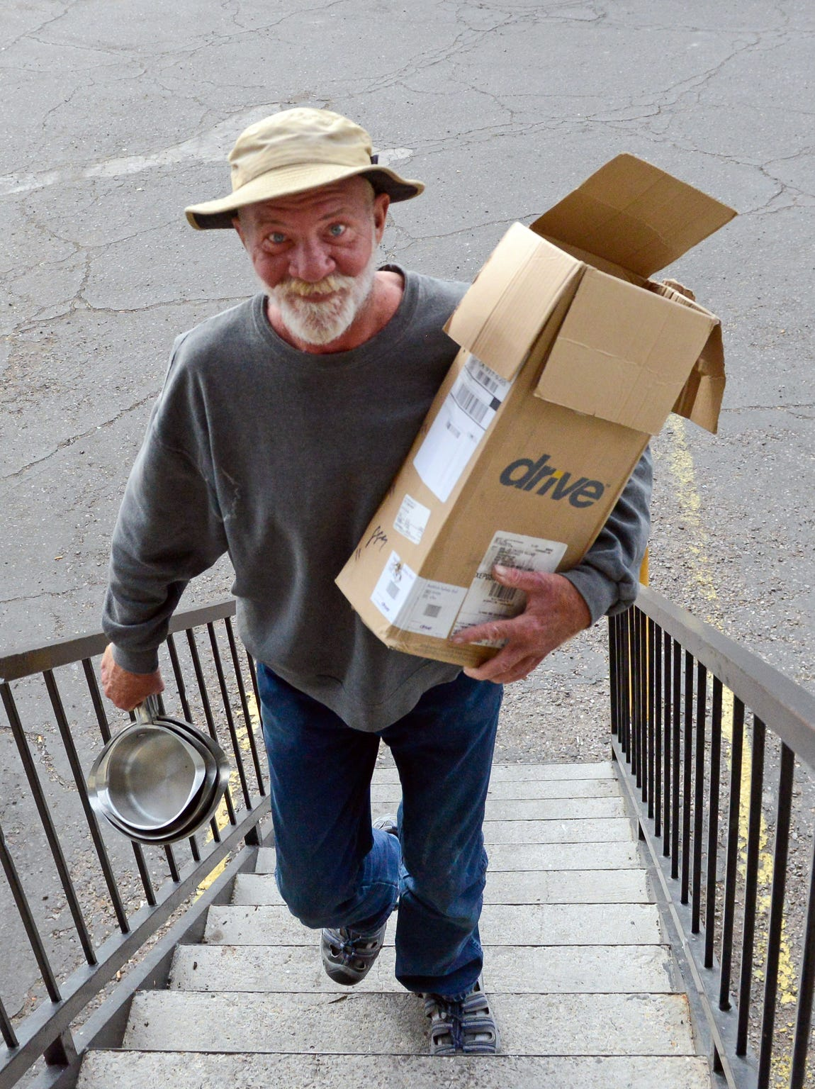 Alan Abrams moves into his new apartment in Las Cruces on Thursday, Nov. 29, 2018. He was moved out of a tent city for the homeless as part of Community of Hope's Tents to Rents program.