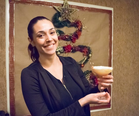Rhiannon Hardin, a bartender at Azul Ultra Lounge in Hotel Encanto poses with her winning cocktail Saturday, Dec. 1, 2018, at Hacienda de Mesilla. Hardin was named Gran Patrón Champion at New Mixico 2018.
