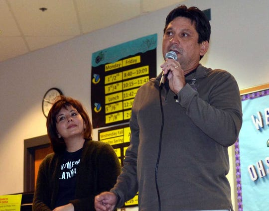 Oñate High School government teacher David Nuñez, right, talks about Stephanie Valenica, left, his former student, during an event Monday, Dec. 3, 2018, at the school. Valencia was a staffer in the White House during the Obama Administration.