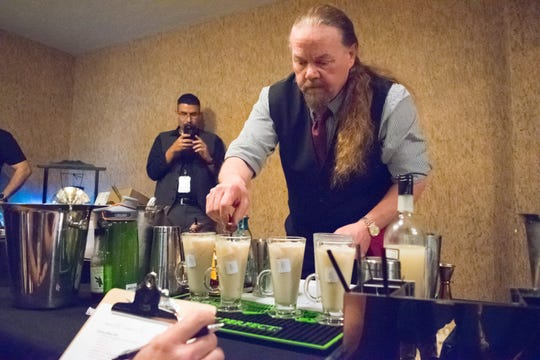 Ed Krause of The Ranchers in Ruidoso puts the finishing touches on his drinks in the semifinal round of the New Mixico 2018 competition Saturday, Dec. 1, 2018, at Hacienda de Mesilla.