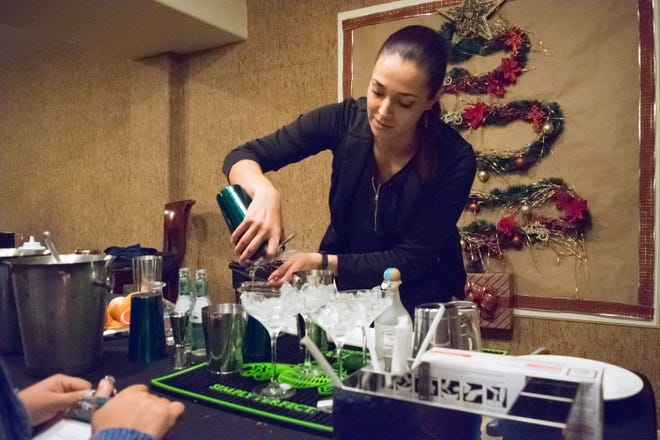 Rhiannon Hardin, a bartender at Azul Ultra Lounge in Hotel Encanto carefully works on her final cocktail of the New Mixico competition held Saturday, Dec. 1, 2018, at Hacienda de Mesilla.