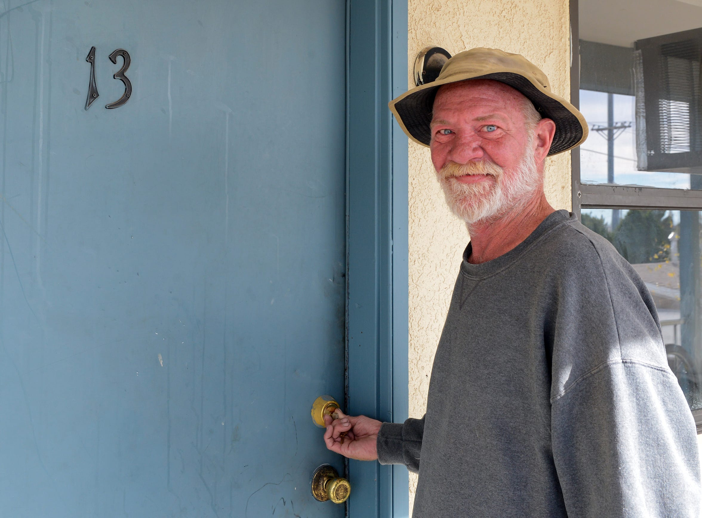 Alan Abrams opens the door of his new apartment in Las Cruces on Thursday, Nov. 29, 2018. He was moved out of a tent city for the homeless as part of Community of Hope's Tents to Rents program.