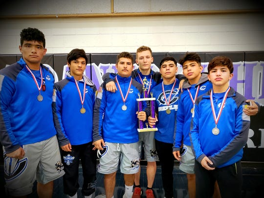 Left to right: Jared Duenez, Anthony Fuentes, RJ Baca, Justin Wood, Fabian Padilla, Alex Najera and Marcus Najera all show off their medals won during Satuday's Franklin Tournament in El Paso, Texas. Carlsbad won the meet.
