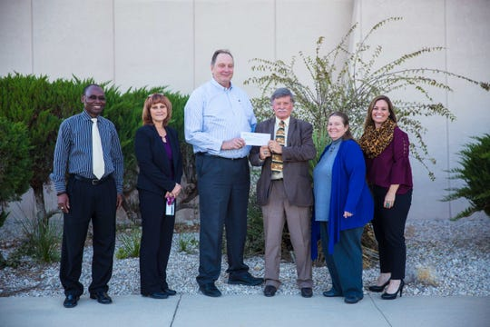 New Mexico State University President Dr. John Gratton receives a $20,000 donation from Chevron for scholarships supporting students in STEM related fields.