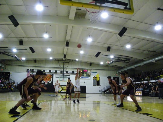 Tigers coach James Voight said that sinking a few more free throws could've helped Alamogordo beat the Belen Eagles in the first game of the 2018-19 season.