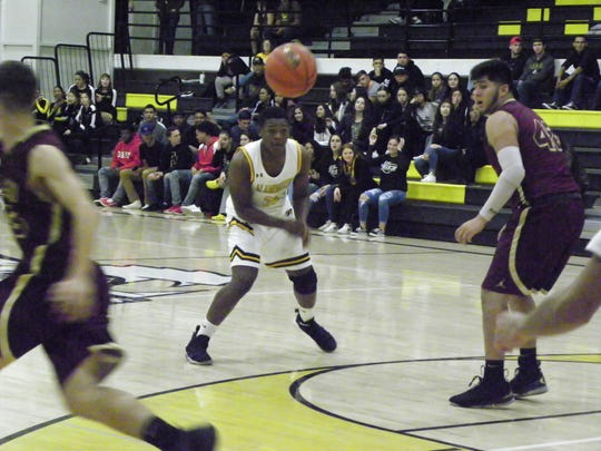 Tigers sophomore Jarmin Williams throws a hard pass during the matchup against the Eagles on Dec. 1.