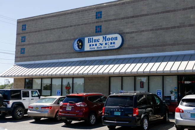 The Blue Moon Diner has settled its lawsuit by a federal agency that alleged the restaurant's management committed religious discrimination against a former employee.