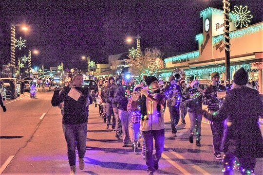 What's a parade without a band, even if it's hard to pucker in the cold.