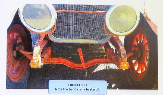 The photo shows the hand crank on the front grill.