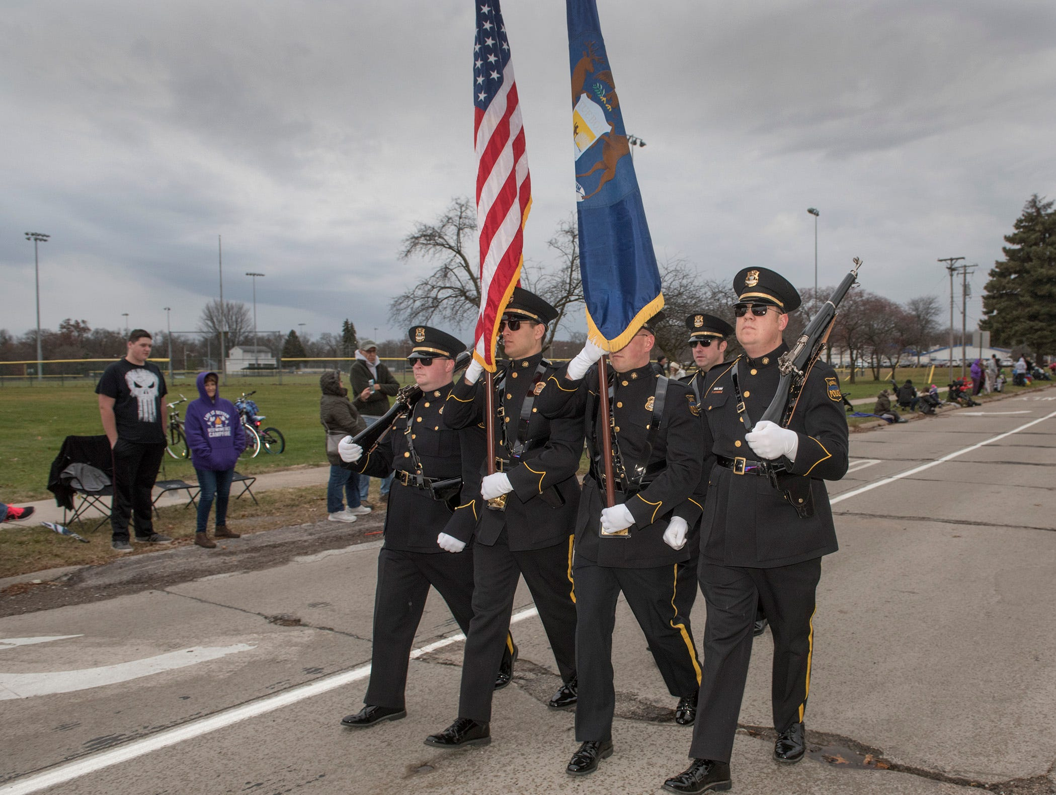 Livonia Police Honor Guard leads off the parade,