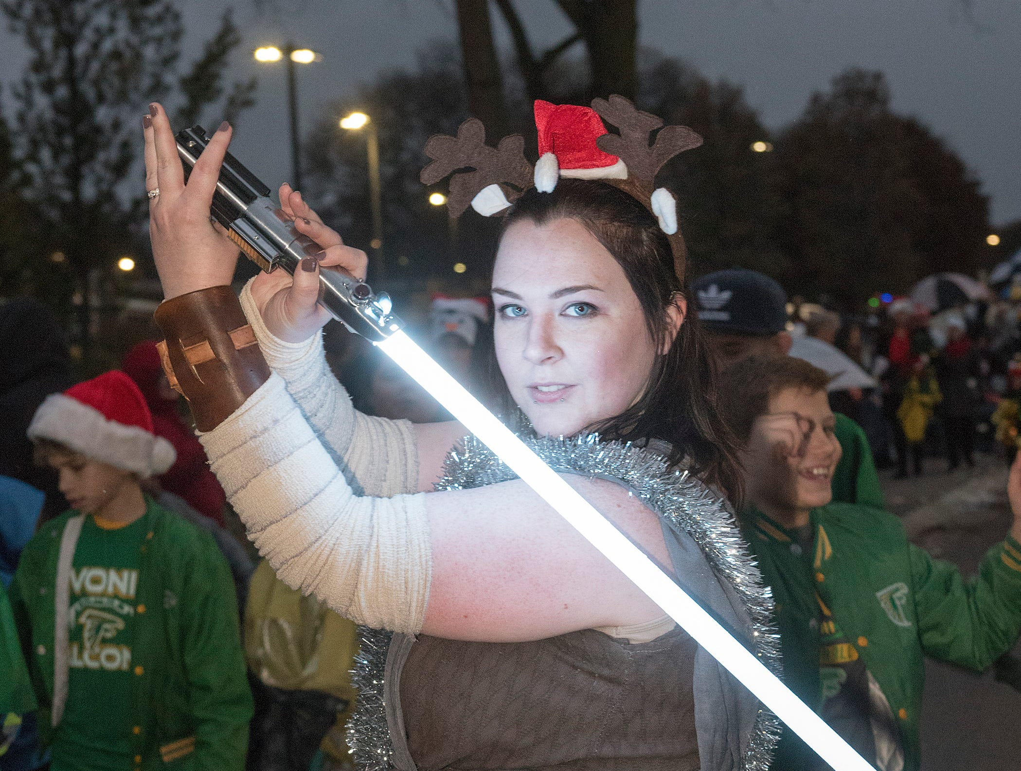 Rey, a Star Wars character, is a member of the Rebel Legion 501st and the Mandalorian Merc, marching in the parade.