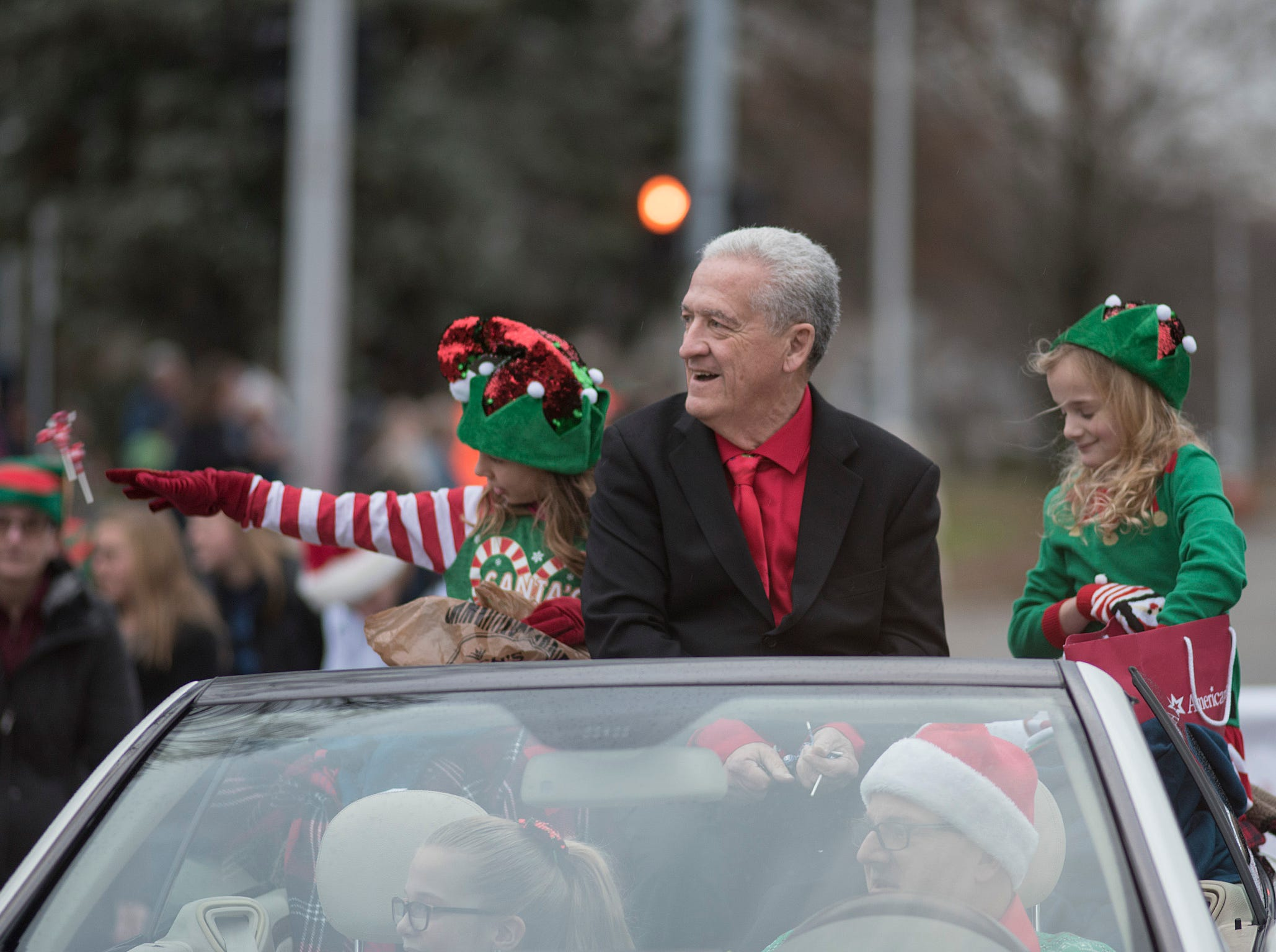 Mayor Dennis Wright and helpers Jillian Sharpe and Macie Miller toss candy to the crowd. Ella Miller rides shotgun