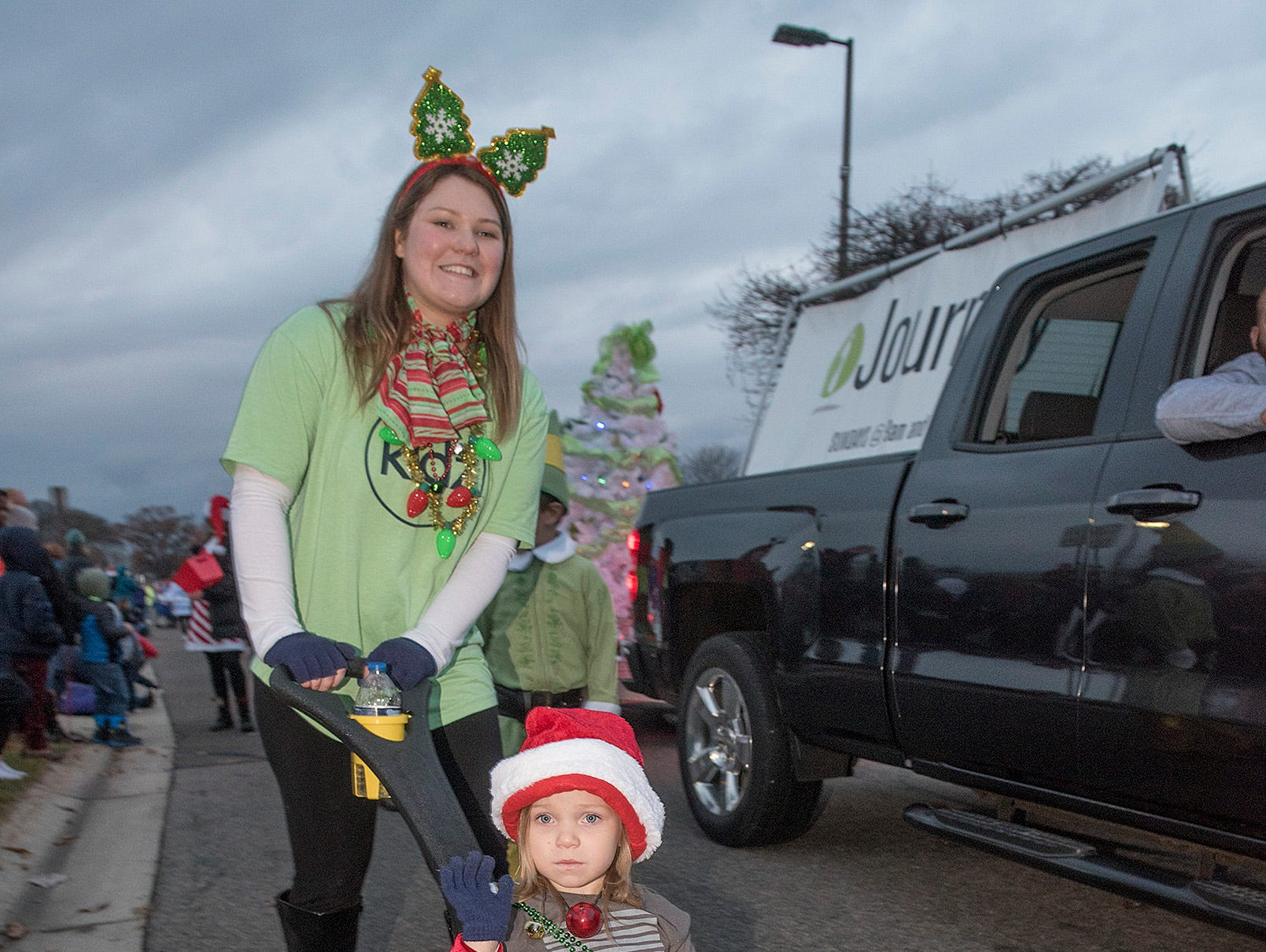 Caitlyn Jones and 3 year old daughter Hadley march in the parade with Journey Church.