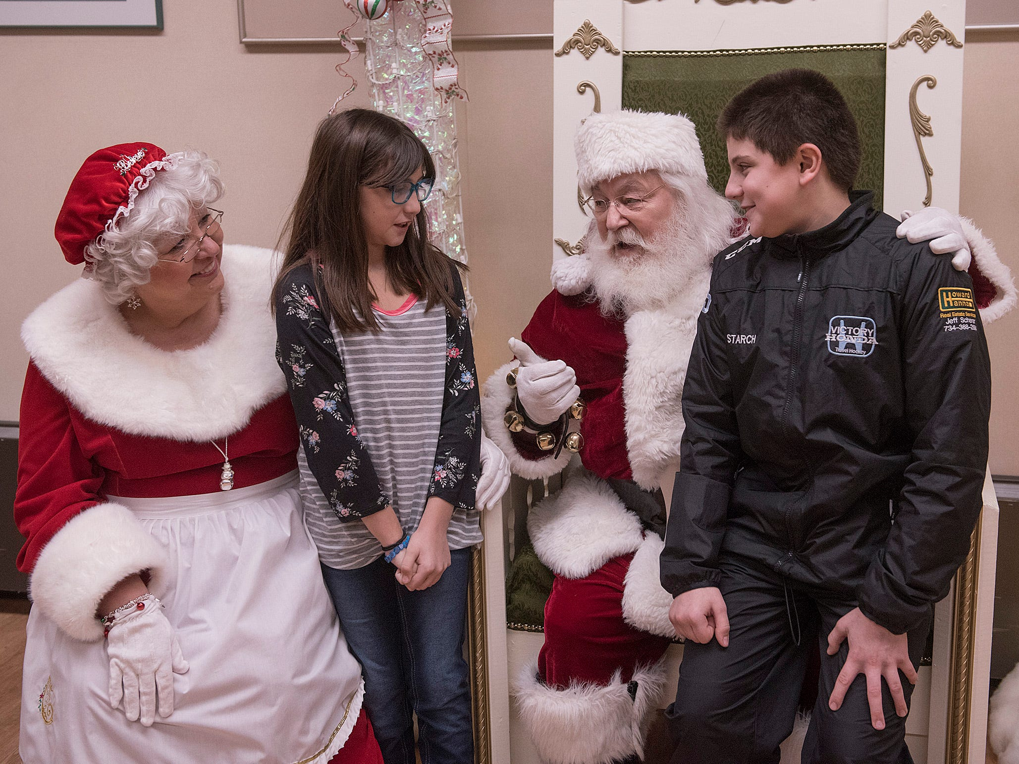 Bethany Starch and brother Sebastian Starch spend a little time with Santa and Mrs. Claus.