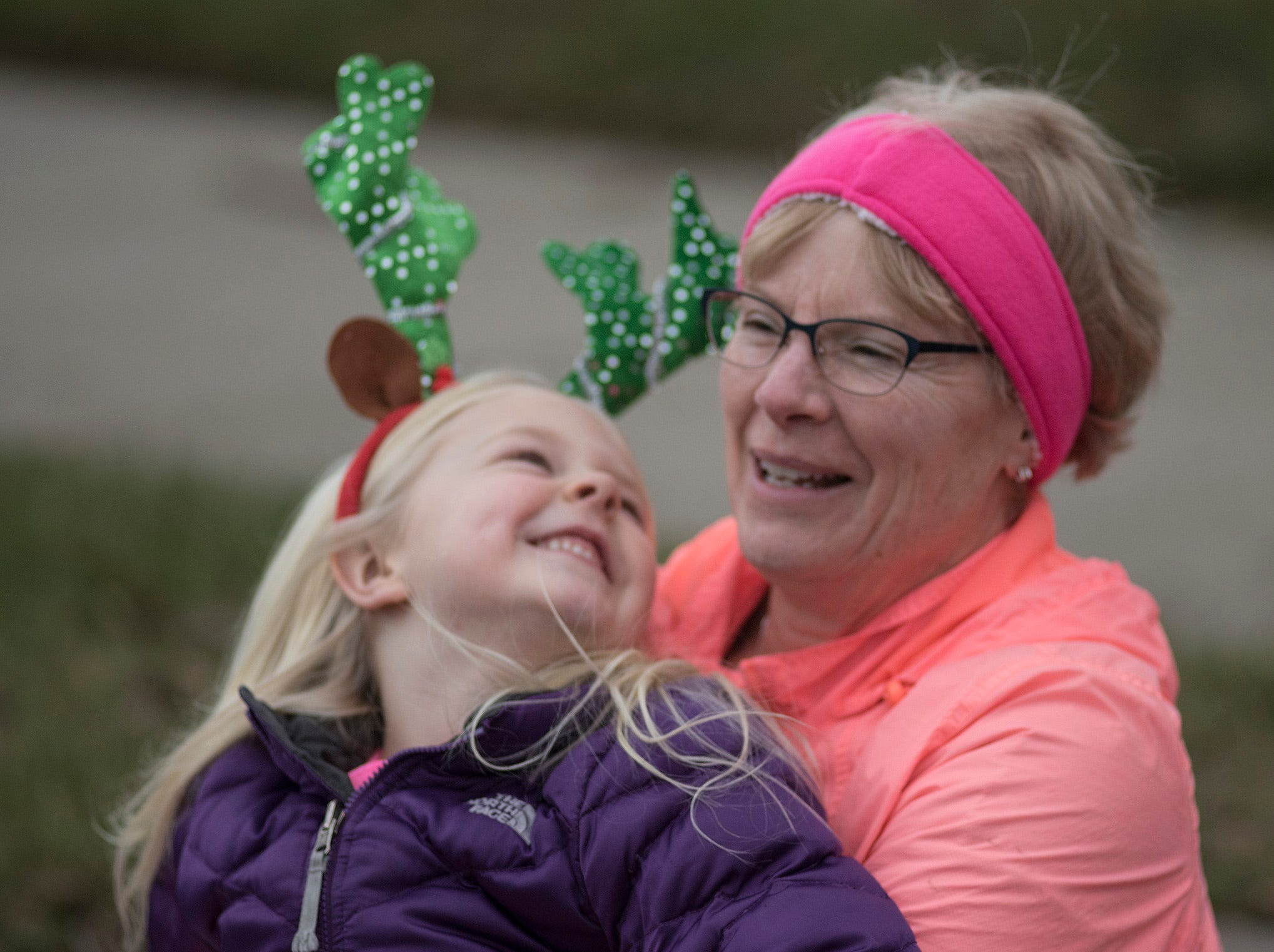 Six year old Annabella Lizear and Grandma Kathy Morrow, waiting for the parade to begin.