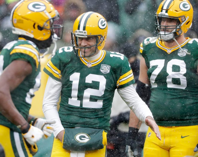 Green Bay Packers quarterback Aaron Rodgers (12) high fives teammates as they are introduced at Lambeau Field on Sunday, December 2, 2018 in Green Bay, Wis.Adam Wesley/USA TODAY NETWORK-Wis