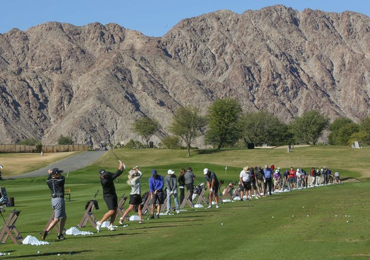 Golfers use the driving range at PGA West where this year's Desert Classic will by played in La Quinta, December 3, 2018.
