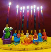 Hanukkah menorahs come in all sizes and shapes. They can be traditional in designs, stylistically modern, or whimsical and creative like this cat version.