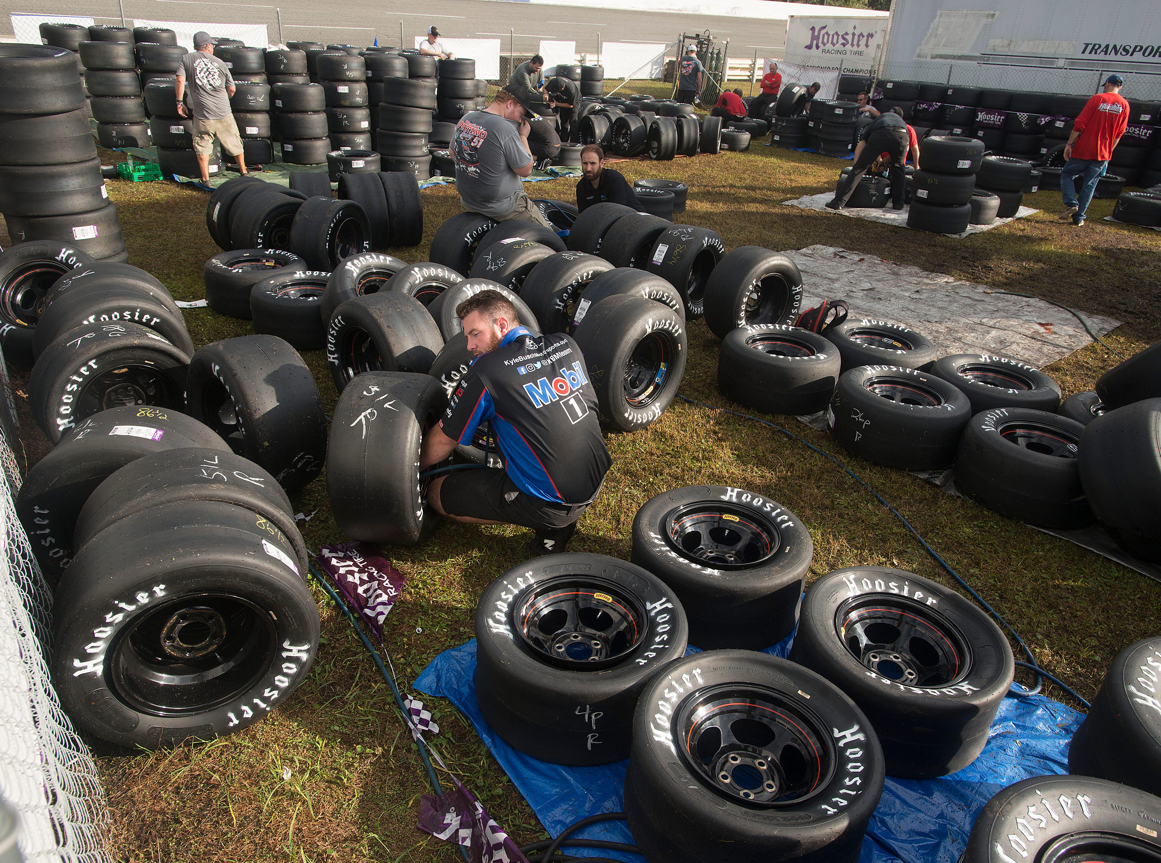 Crew members get tires ready Sunday, December 2, 2018 during the 51st annual Snowball Derby at Five Flags Speedway.