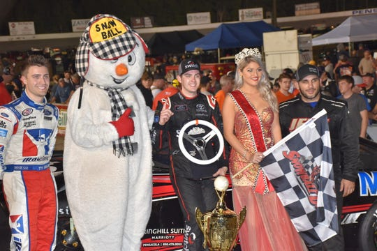 51st Snowball Derby winner Noah Gragson (center) is joined by Miss Snowball Derby Helena Ciappina along with second-place finisher Ty Majeski (far left) and third place finisher Jeff Choquette in Victory Lane on Dec. 2 at Five Flags Speedway