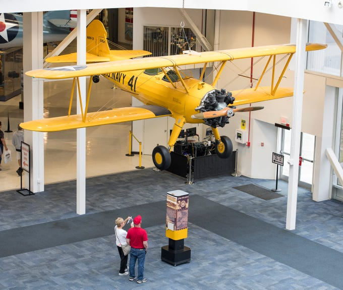 Sue and Frank Shelton, of Chandler, Indiana, check out the Stearman biplane flown by President (then cadet) George H.W. Bush while training during World War II on display at the National Naval Aviation Museum in Pensacola on Monday, December 3, 2018.