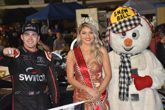 Snowball Derby winner Noah Gragson shows off his Snowball Derby championship ring, joined by Miss Snowball Derby Helena Ciappina, a Tate High grad and PSC student, along with Snowball mascot .