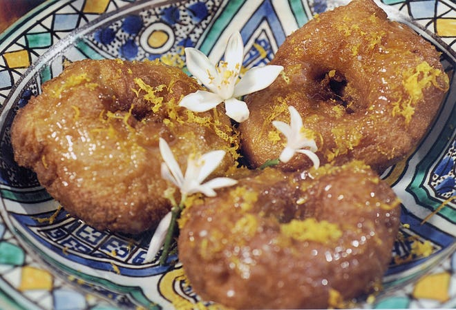 Warm fragrant drafts of yo-yos frying in olive oil permeate the streets of Tunisia.