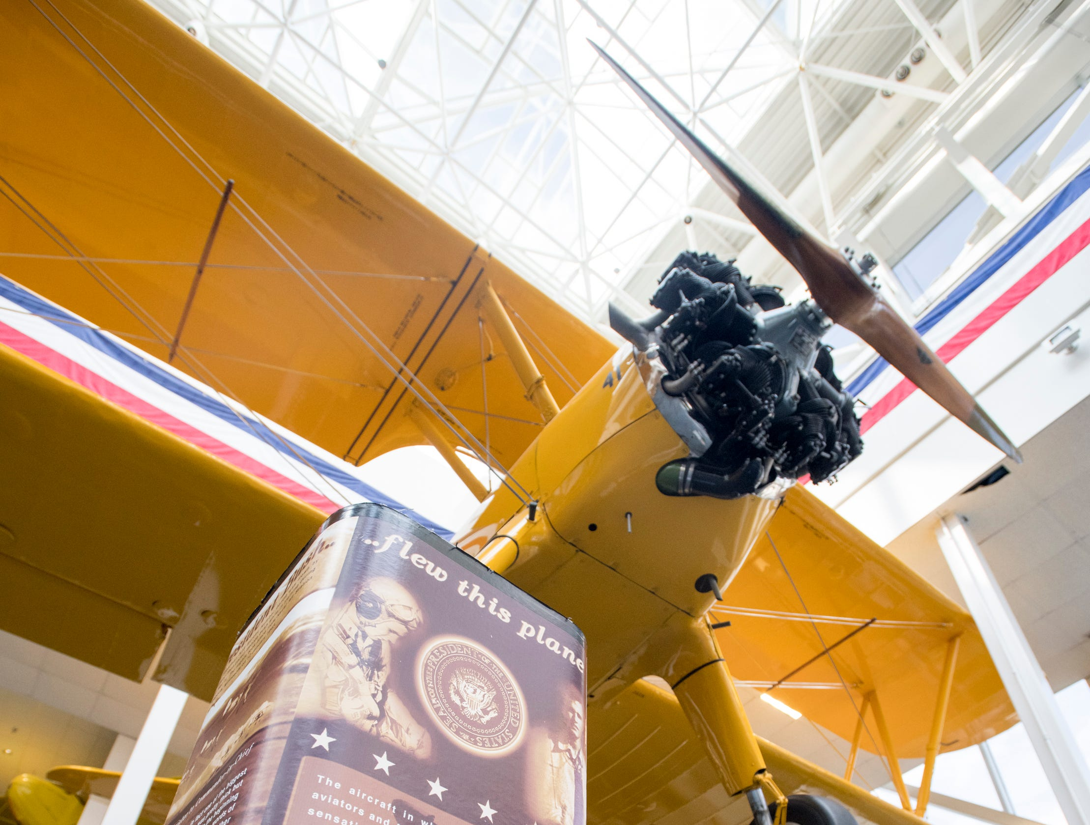 A Stearman biplane flown by President (then cadet) George H.W. Bush while training during World War II is on display at the National Naval Aviation Museum in Pensacola on Monday, December 3, 2018.
