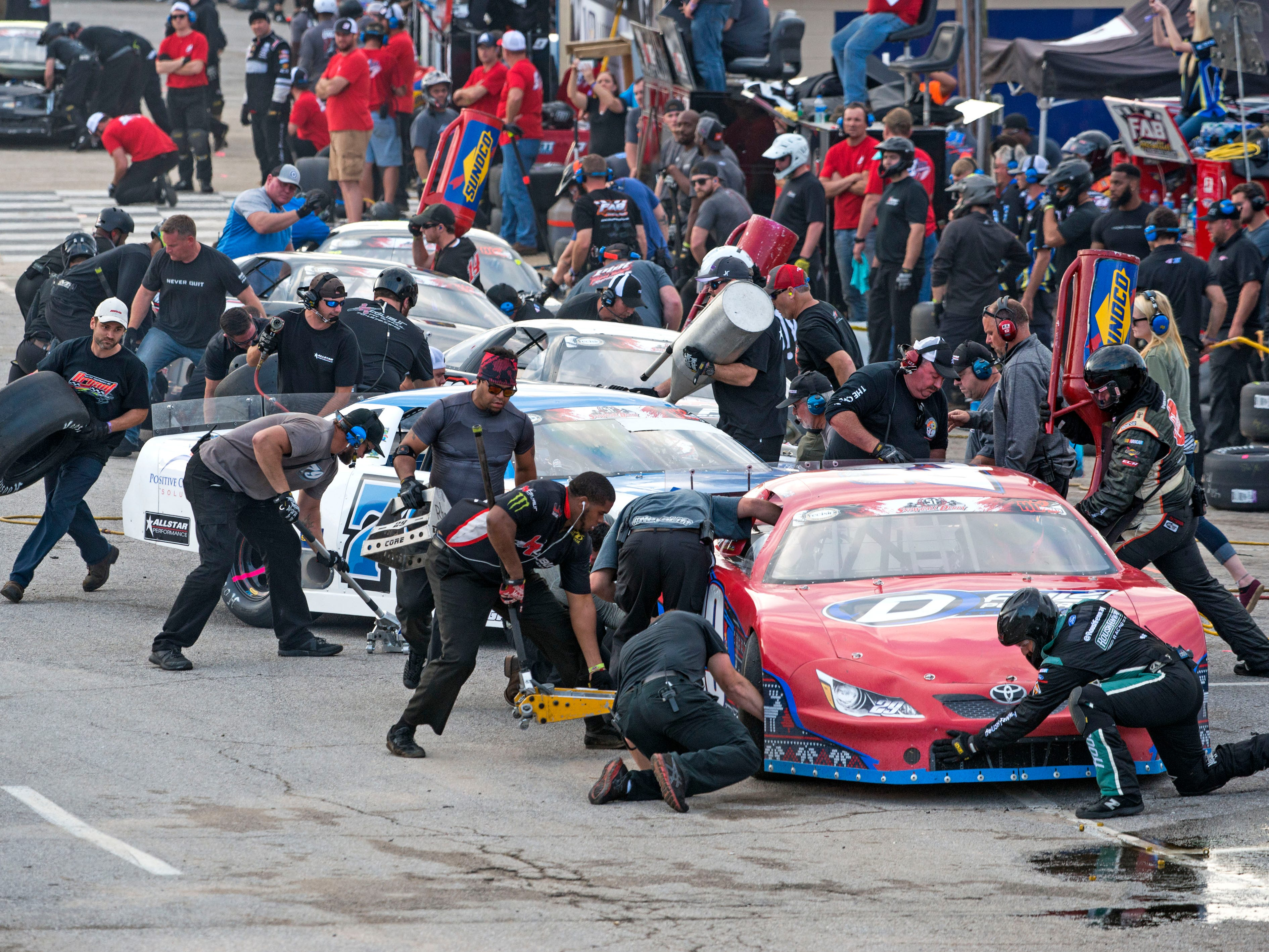 Cars come in for a pitt stop Sunday, December 2, 2018 during the 51st annual Snowball Derby at Five Flags Speedway.