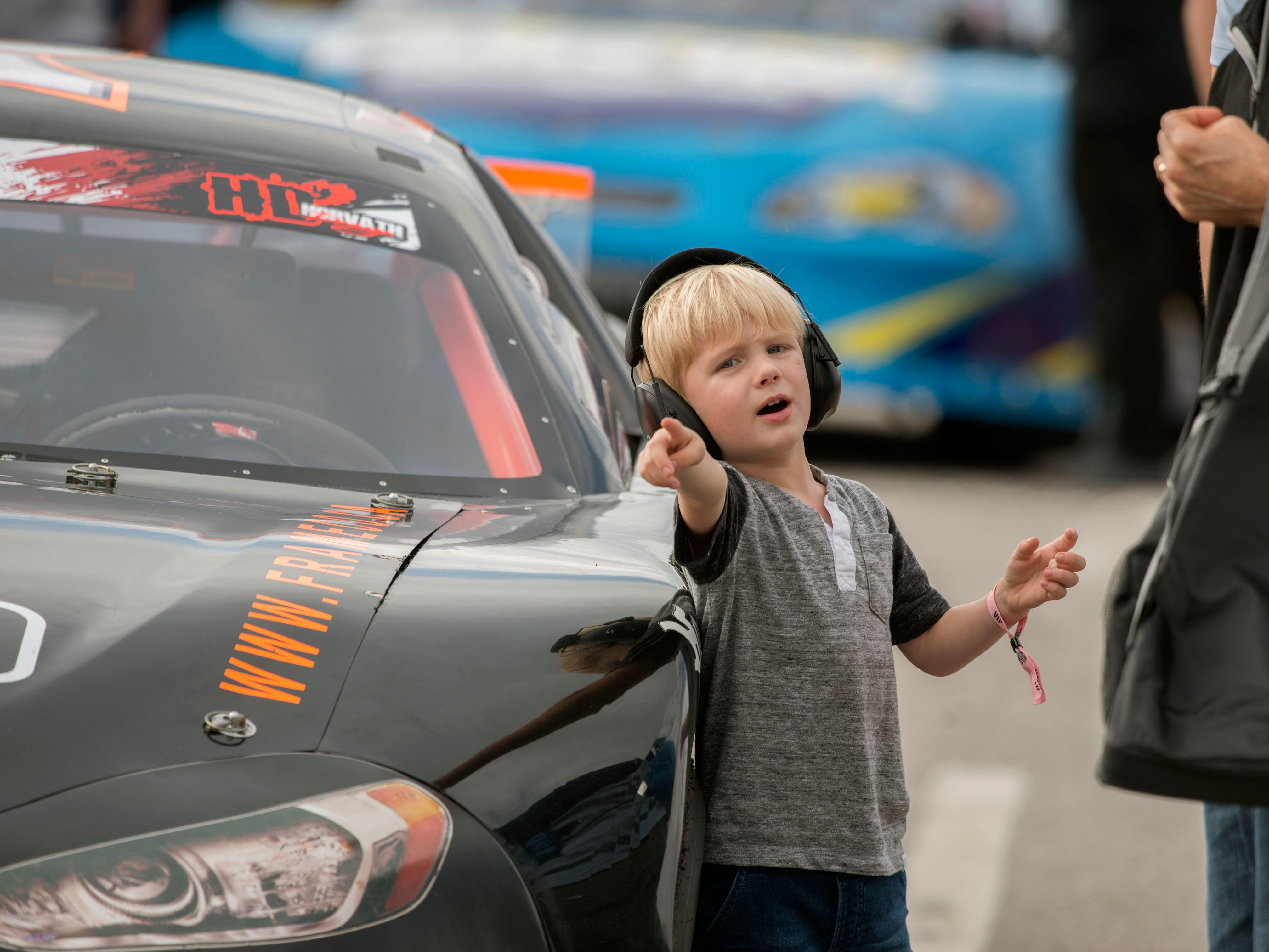 Cooper Burks,3, checks out the cars Sunday, December 2, 2018 during the 51st annual Snowball Derby at Five Flags Speedway.