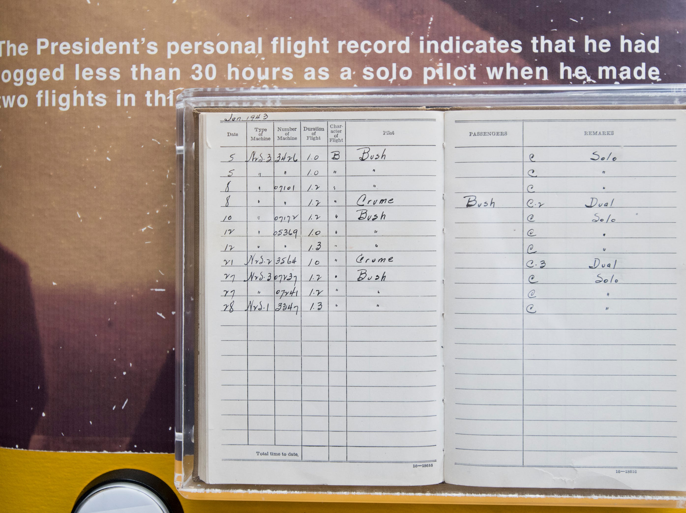 President George H.W. Bush's logbook is displayed near the Stearman biplane flown by him while training as a cadet during World War II at the National Naval Aviation Museum in Pensacola on Monday, December 3, 2018.