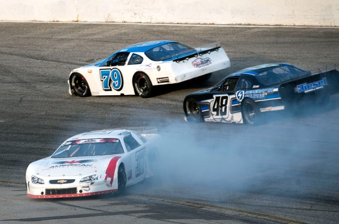 A car spins out on turn two Sunday, December 2, 2018 during the 51st annual Snowball Derby at Five Flags Speedway.