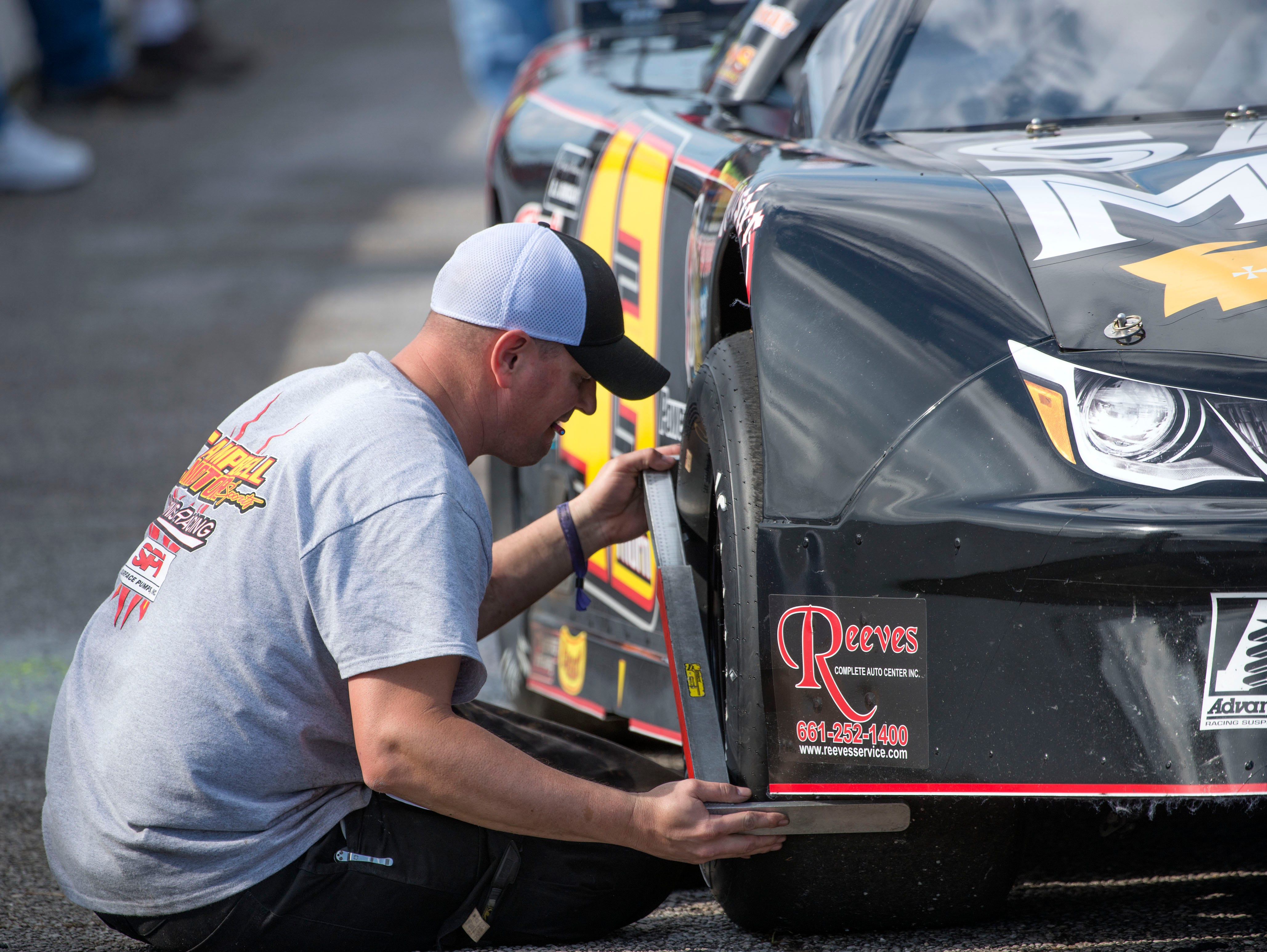 Crew members get cars ready Sunday, December 2, 2018 during the 51st annual Snowball Derby at Five Flags Speedway.