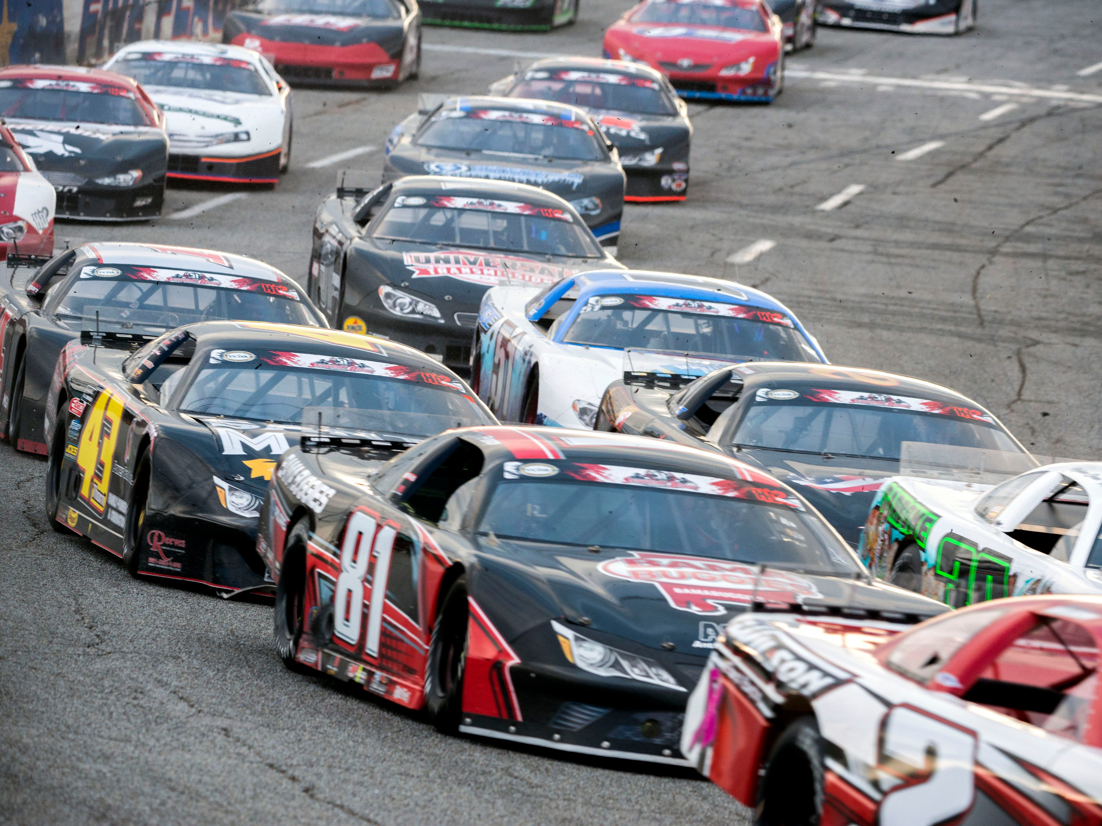Racers make their way around the track Sunday, December 2, 2018 during the 51st annual Snowball Derby at Five Flags Speedway.