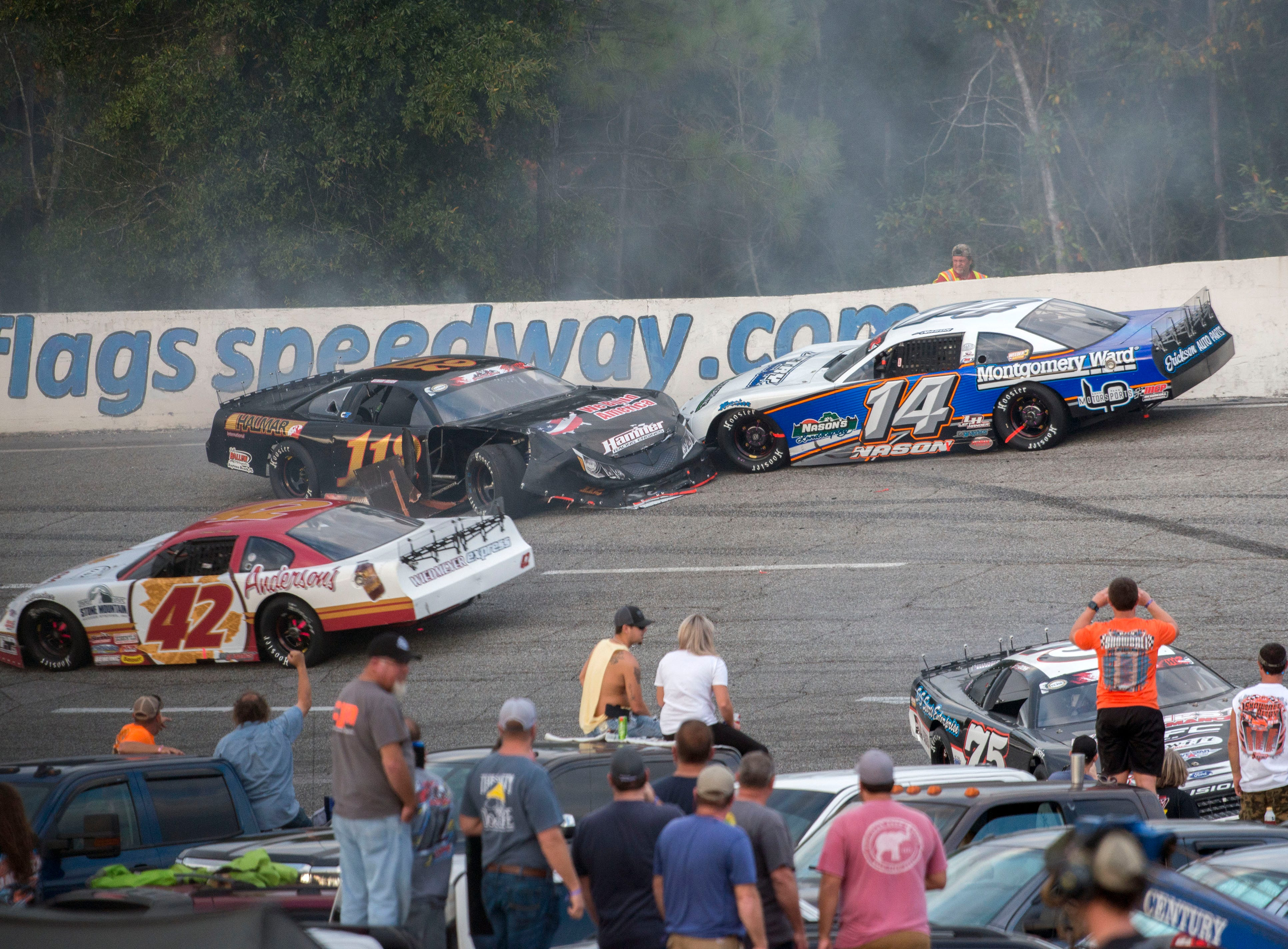 Cars collide in turn two Sunday, December 2, 2018 during the 51st annual Snowball Derby at Five Flags Speedway.