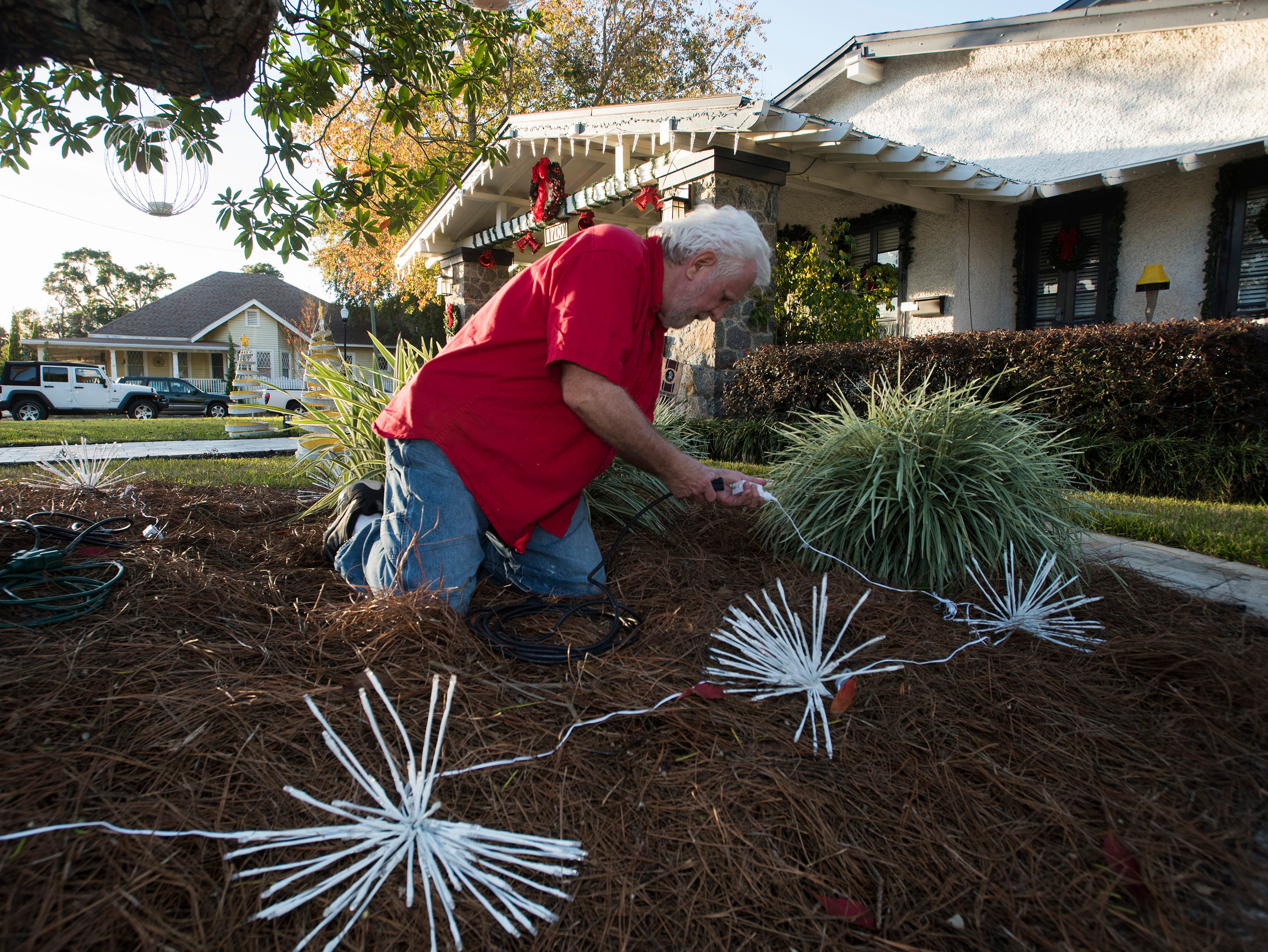 Pensacola resident, Mike Burleson, prepares for the Christmas season at his 17th Ave. home on Monday, Dec. 3, 2018. Burleson's house at the corner of 17th and Gadsden Street will feature a minimum of decorations this year after years of over-the-top seasonal decorations.