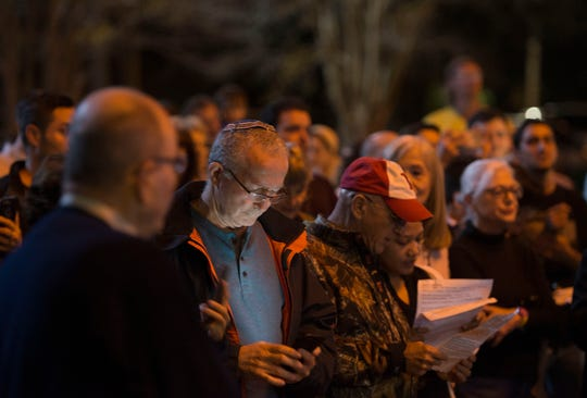 The crowd sings Sunday during the Pensacola Chabad Jewish Center's Grand Menorah Lighting at Pensacola City Hall to mark the start of Hanukkah.
