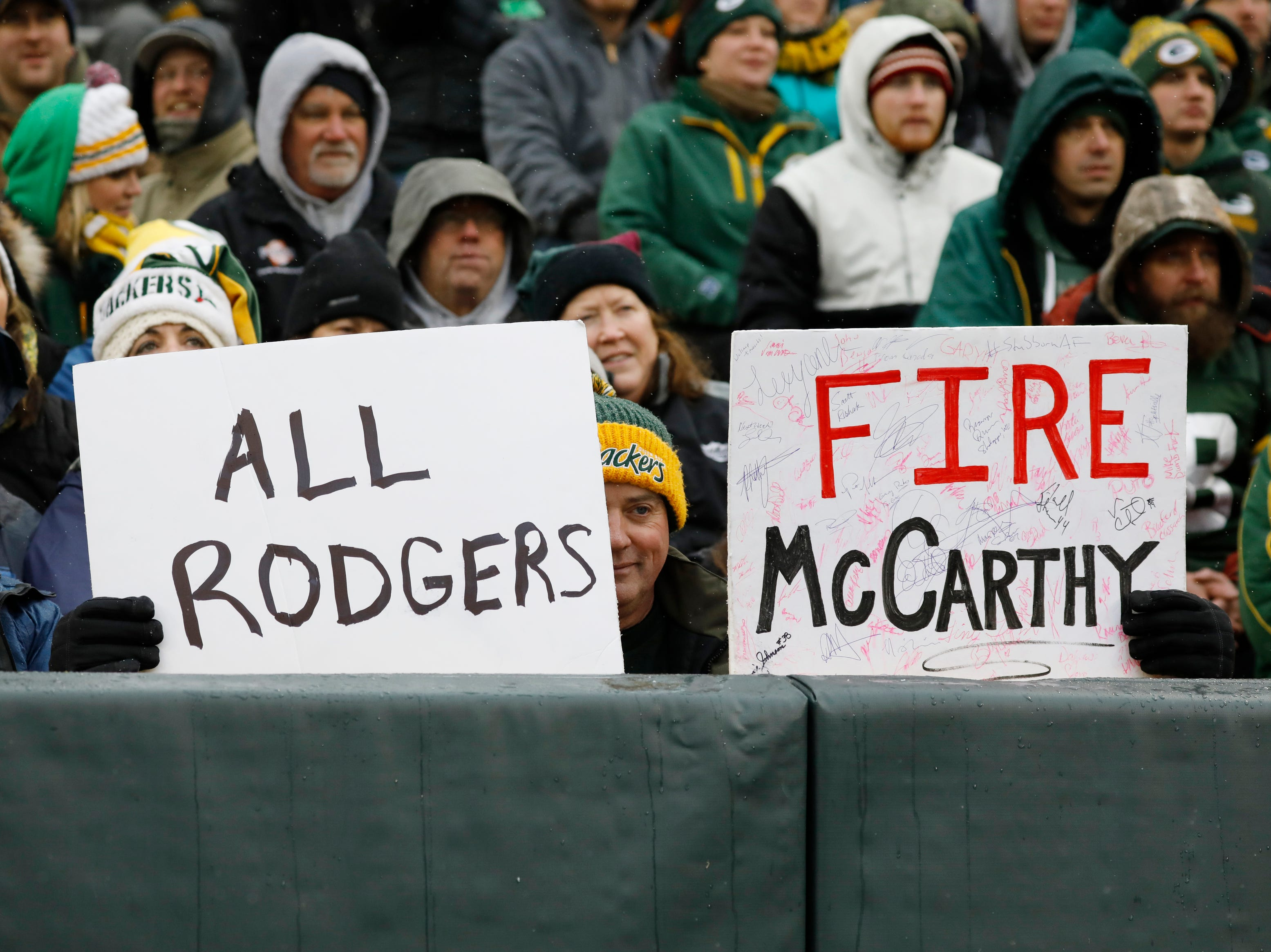 A fan holds up a sign during the fourth quarter of the Green Bay Packers the Arizona Cardinals Sunday, Dec. 2, 2018, in Green Bay, Wis. Arizona won 20-17. Green Bay head coach Mike McCarthy was fired after the game.