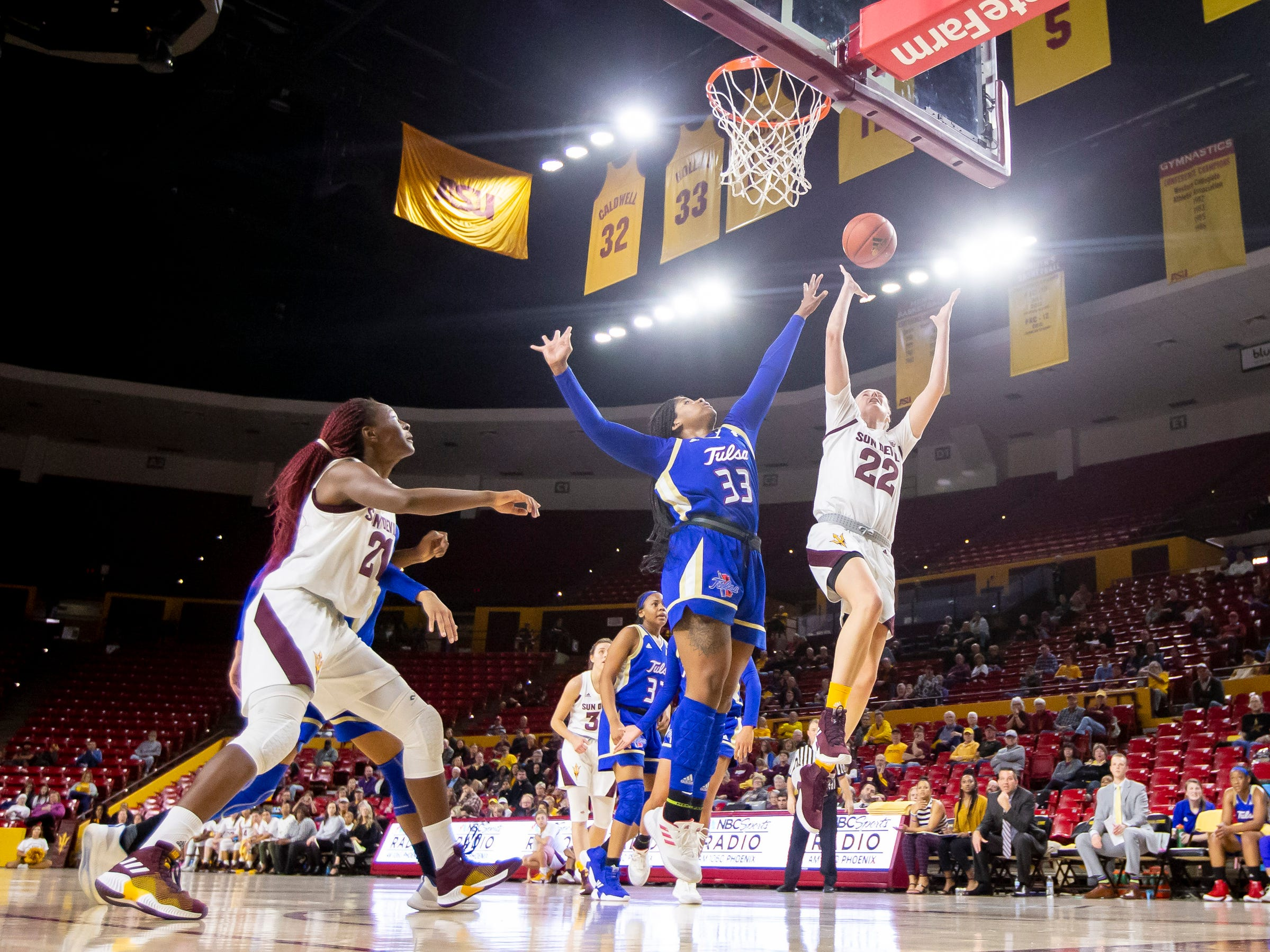 Courtney Ekmark (22) of the Arizona State Sun Devils shoots against forward Crystal Polk (33) of Tulsa Golden Hurricane at Wells Fargo Arena on Sunday, December 2, 2018 in Tempe, Arizona.