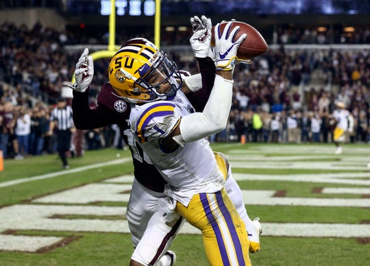 LSU Tigers wide receiver Ja'Marr Chase (1) is unable to make a reception as Texas A&M Aggies defensive back Myles Jones (10) defends during overtime at Kyle Field on Nov. 24.