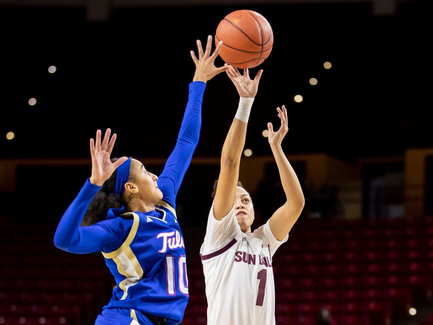 Guard Reili Richardson (1) of the Arizona State Sun Devils shoots against guard Alexis Gaulden (10) of Tulsa Golden Hurricane at Wells Fargo Arena on Sunday, December 2, 2018 in Tempe, Arizona.