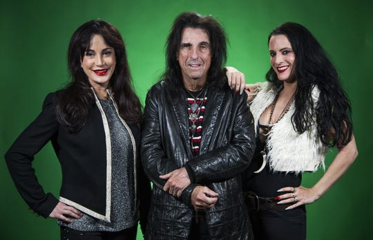 Alice Cooper and his wife, Sheryl, left, and daughter Calico, right, pose in the Arizona Republic photo studio, Wednesday, November 14, 2018.