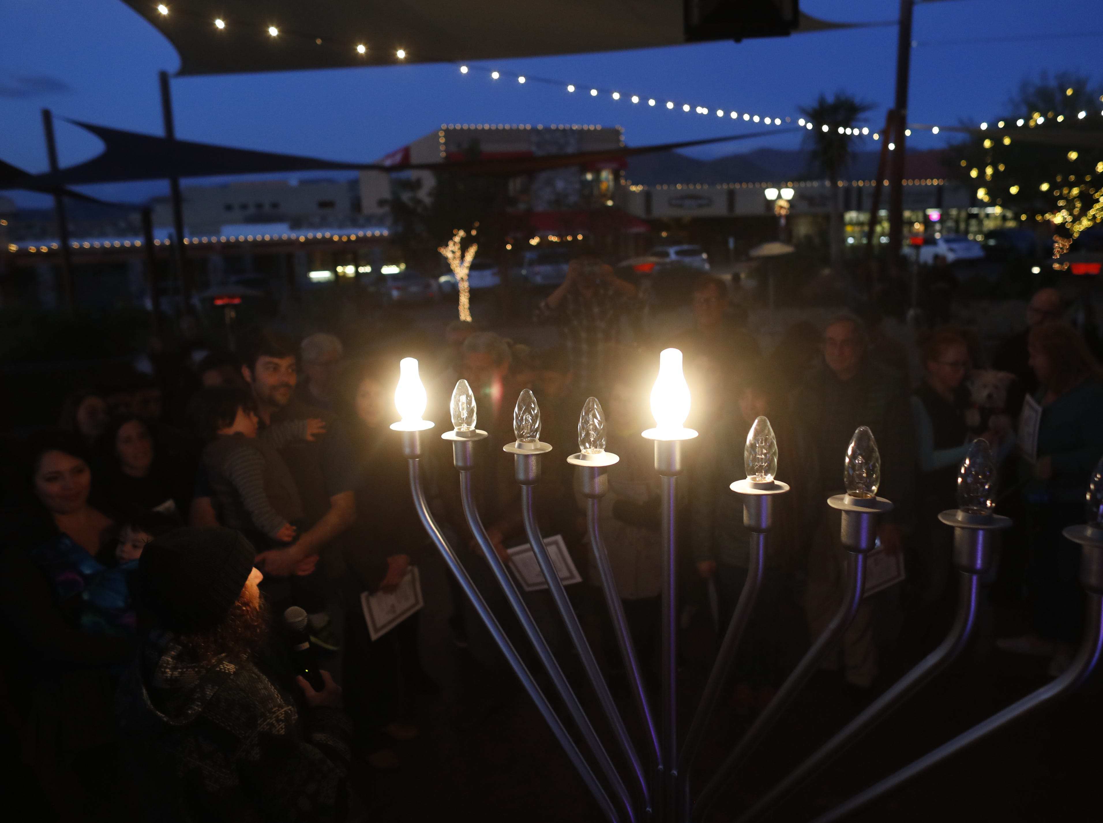 The menorah lights up during a Menorah Lighting Ceremony on the first night of Hanukkah at Carefree Desert Gardens in Carefree, Ariz. on December 2, 2018.