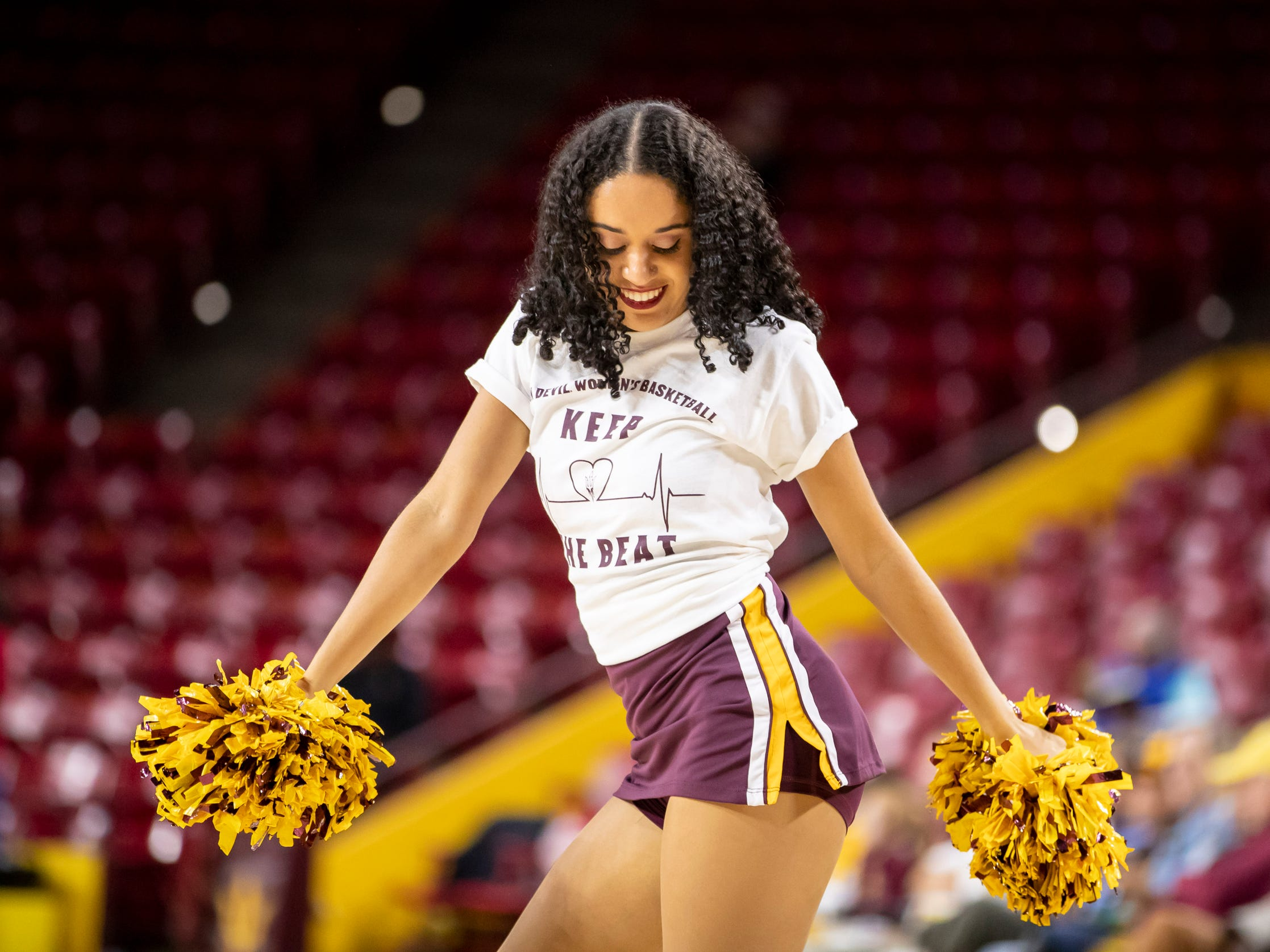 An Arizona State cheerleader cheers during the game against Tulsa Golden Hurricane at Wells Fargo Arena on Sunday, December 2, 2018 in Tempe, Arizona.