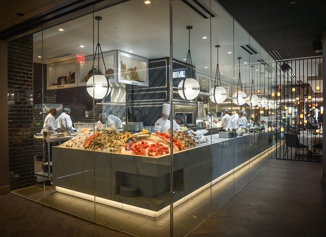 The glass-enclosed kitchen at Ocean 44 in Scottsdale gives diners a view of the raw bar.