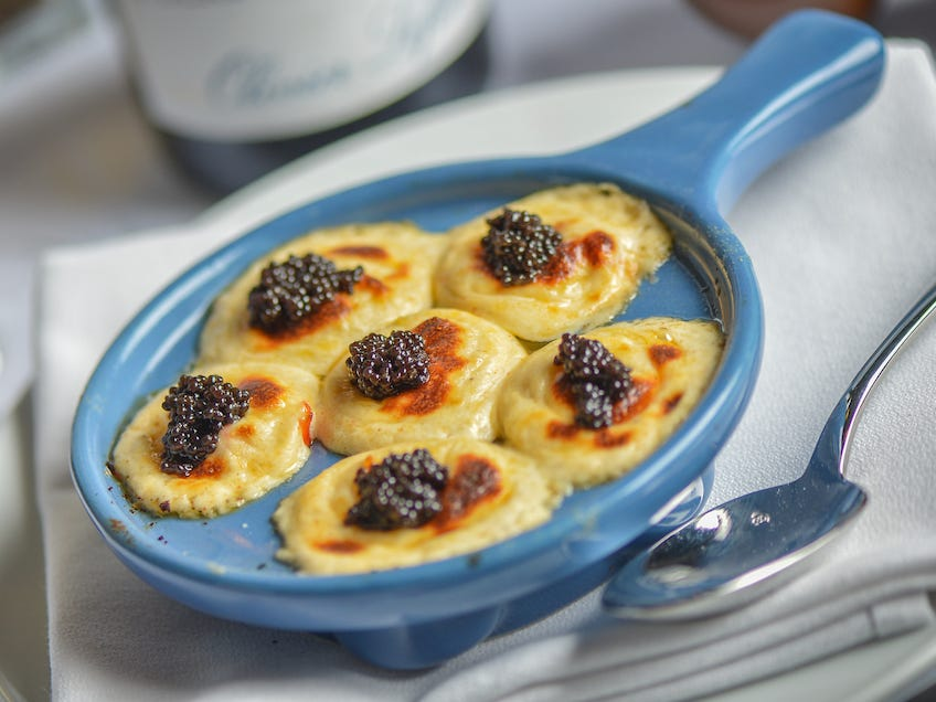 Lobster escargot at Ocean 44 in Scottsdale is topped with Mornay sauce and caviar.